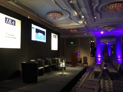 A black stage setup for the IBA event