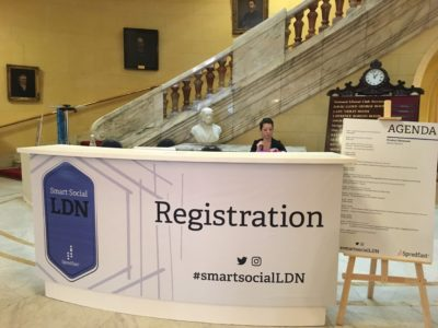 A lady in the Smart Social LDN's registration desk
