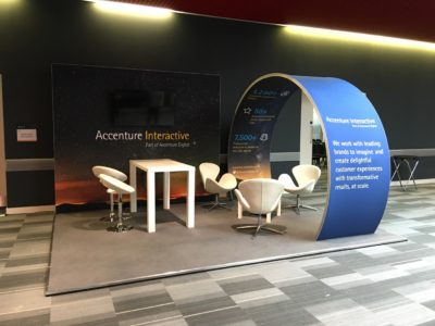 Set design with white chairs and a table for Accenture Interactive