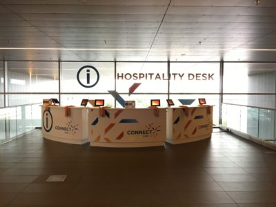 Teradata Connect 2016 information desks with monitors.