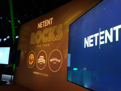 Two big flat screens on the stage for the tour event of netent rocks