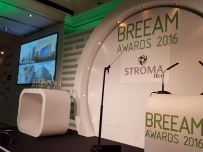 Stage setup with LCD screen, tokens for the awardees and podiums with microphones for the BREEAM Awards 2016