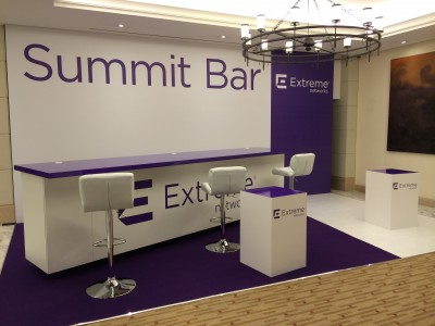 White chairs, tables and chandeliers at the Summit Bar Booth
