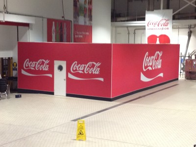 Coca Cola exhibit hall and banners on wall