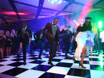 The guests at the party dancing on a checkered floor