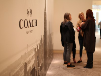 A group of women talking at Coach Exhibit in New York