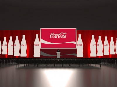 Coca-cola 3D stage setup and black chairs for guests