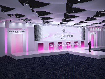 The 3D stage set up with white chairs and a man standing in front at the House of Fraser event