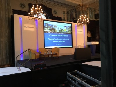 A stage setup with chandeliers at the 5th Annual domain Seminar