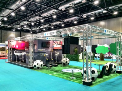 Eclipse stage and exhibit booth on an artificial turf