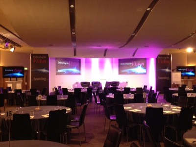 Stage setup with purple lightings and the reserved tables and seats for the guests