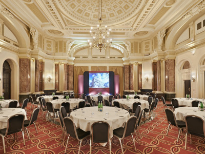 The Ballroom at Amba Hotel Charing Cross hotel with elegant sculpted ceiling and chandeliers