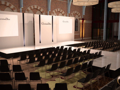 Plain white stage setup and reserved seats at the Christian Dior event