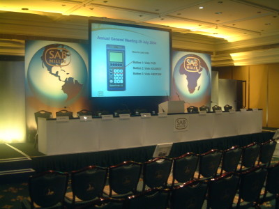 A long table for speakers and a big screen at Sab Miller Conference in Intercontinental Park Lane.