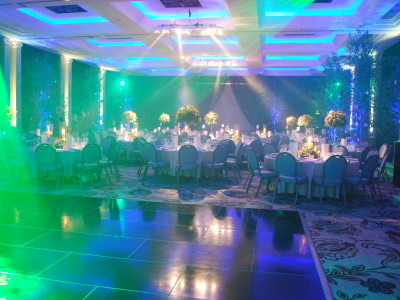 A venue with creative lightings, flower arrangements, and reserved tables for guests