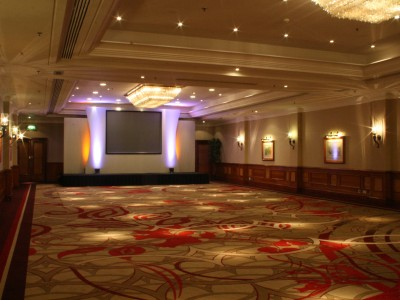 A venue with a simple stage setup and lightings