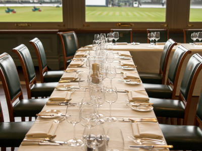 Long dining table with wine glasses on top at the Lord's Home of the Cricket
