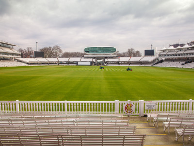 Green field and white bleachers at the Lord's cricket ground