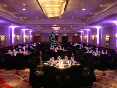Reserved black seats for guests and creative lightings in an event