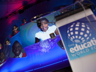 The Education World Forum big screen showing the images of the children.