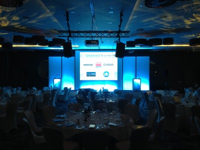 Table setup and the stage at a themed party event at Hilton Wembley Hotel.