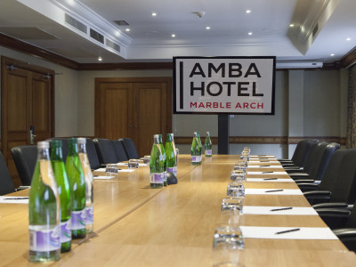 A long table with bottled drinks at the Amba Hotel