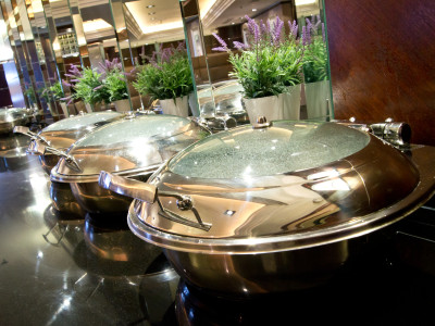 Few casseroles on top of the table at Amba Hotel