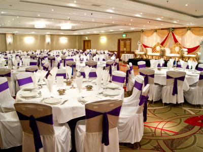 Reserved white tables and seats in an event