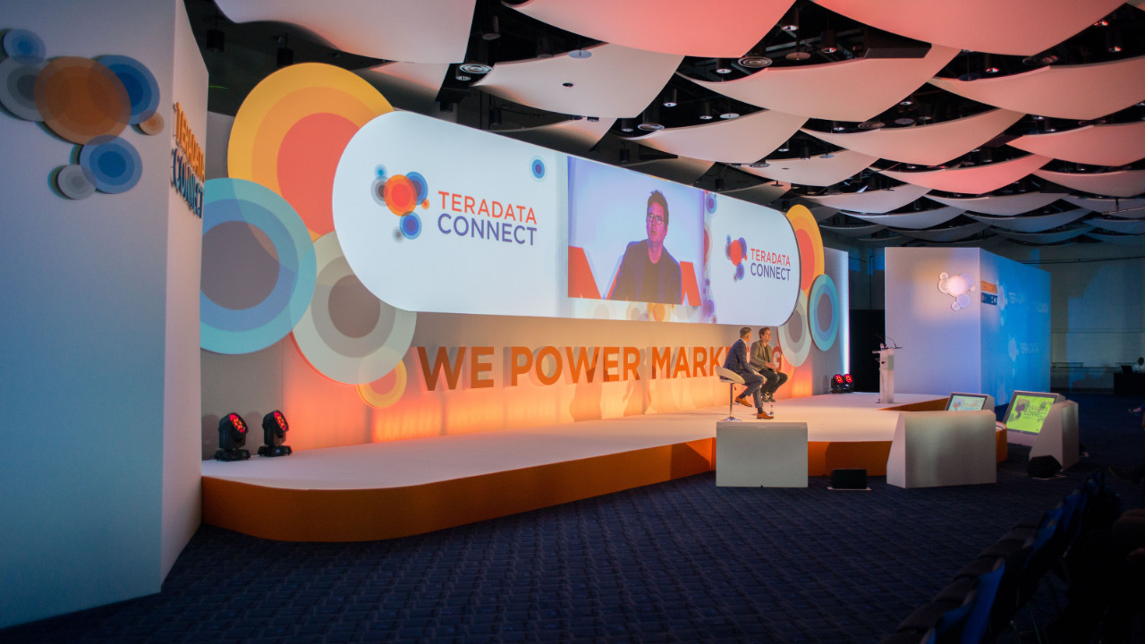 Teradata Connect - Set design example with 3D projector, engaging lighting and impactful stage presence.