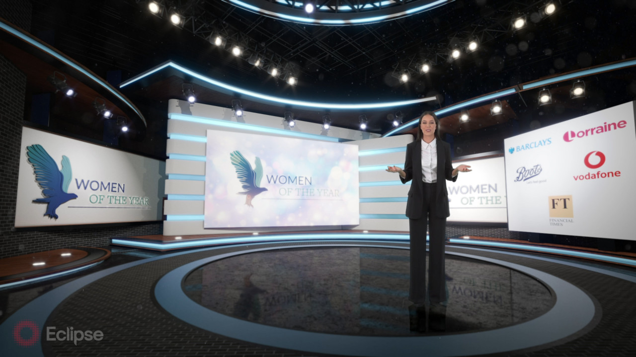 Virtual Set Design - example of a virtual or hybrid event combining a virtual stage presence within a physical environment